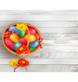 Easter background with color easter eggs in basket vector image vector image