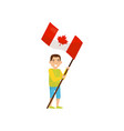 boy holding national flag of canada design vector image
