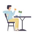 man eats a bun at table vector image vector image