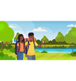 couple tourists hikers using compass searching vector image vector image