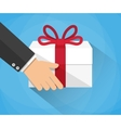 Hand carrying a gift box vector image vector image