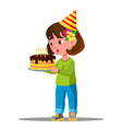 kid blowing out candles on holiday cake vector image
