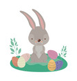 easter landscape scene with rabbit and easter eggs vector image vector image