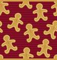 seamless pattern of gingerbread men on a red vector image vector image
