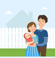 young happy family with newborn baby standing vector image