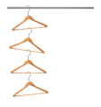 Coat hangers hanging on a clothes rail vector image vector image