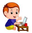 cute boy using laptop computer vector image