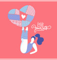 happy woman holding a big heart on her legs vector image vector image