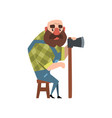 Bald forest man sitting on wooden chair and