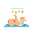 cute naked baby in a diaper lying in bed vector image