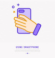 smartphone in hand making photo thin line icon vector image vector image