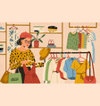 stylish female choosing clothes in boutique vector image