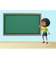 A boy near the empty blackboard vector image vector image