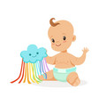 sweet smiling baby in a diaper playing with toy vector image vector image