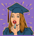 university graduate girl paints lips with lipstick vector image vector image
