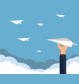 human hand holds a paper airplane vector image vector image