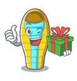 with gift sleeping bad mascot cartoon vector image