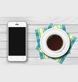 white smartphone with black blank screen and cup vector image