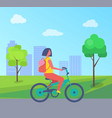 woman riding on bike at green trees and houses vector image