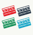 under construction sign in four colors vector image