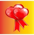two red hearts with ribbons vector image vector image