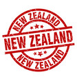 new zealand red round grunge stamp vector image vector image