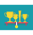Trophy and awards on shelf vector image vector image
