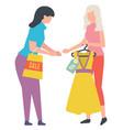seller holding hanger with dress sale vector image