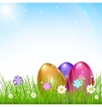 Multicolored eggs in grass with flowers vector image vector image