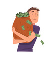 successful young man hugging big heavy sack full vector image vector image