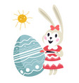 easter bunny painting egg with ornaments preparing vector image