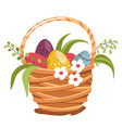 woven basket with painted eggs and flowers vector image