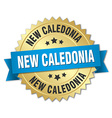 New Caledonia round golden badge with blue ribbon vector image vector image