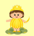 baby in a banana costume vector image vector image