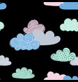 Beautiful seamless pattern of doodle clouds