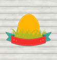 Vintage label with Easter egg on wooden background vector image vector image