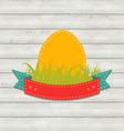 Vintage label with Easter egg on wooden background