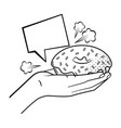 hand holding donut black and white vector image vector image
