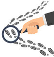 detective s hand holds a magnifying glass traces vector image vector image