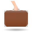 brown classic suitcase travel bag with hand vector image