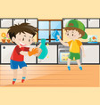 two boys cleaning in the kitchen vector image vector image