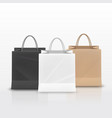 realistic paper shopping bag with handles set vector image vector image