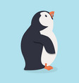 penguin bird eating fish vector image vector image