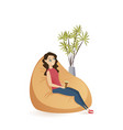 young woman sitting calm in brown beanbag chair vector image