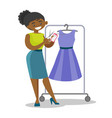 african woman cutting price tag off new dress vector image vector image