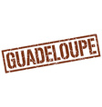 Guadeloupe brown square stamp vector image vector image
