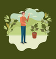 young man planting tree in the park vector image vector image