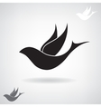 Stylized black silhouette of a flying bird vector image
