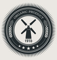 retro styled badge with windmill vector image
