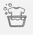 t-shirt in basin with foam hand drawn sketch icon vector image